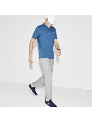 Pantalon survêtement uni gris chinés .